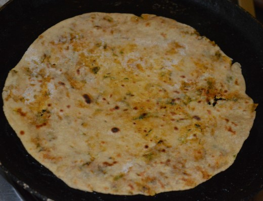 Step twelve: Roast both sides sprinkling some oil and ghee mix. Radish paratha is ready!