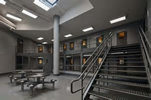 16 cells line up and downstairs of cell block c. The day area has one shared shower, one toilet, one television set and a few metal tables.