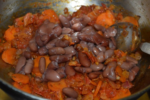 Step seven: Throw in cooked beans. Mix well and stir-cook for a few seconds.