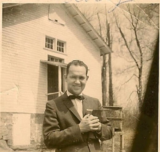 1955, One of the only photos surviving of Daddy in front of the old church at Liberty Grove, his first pastorate.