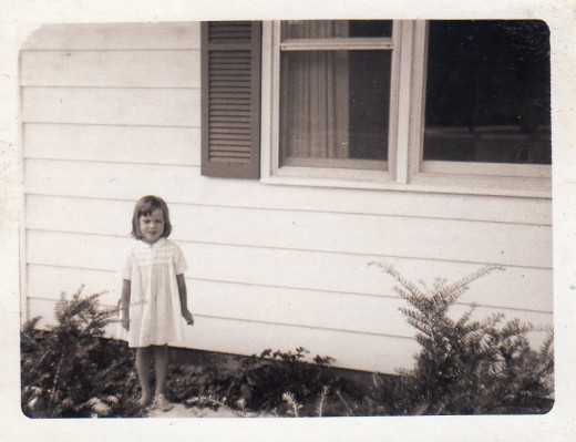 My baby sister, Resa, in front of the house on Mountain Hill Road where she enjoyed so many years with Mama and Daddy.