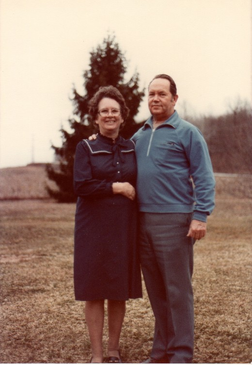 1984, Daddy and Mama on the front lawn.  Daddy was always her protector.