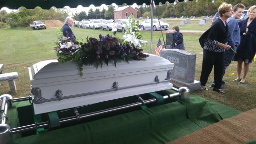 Mama was laid to rest next to Daddy. To the right is Nancy and Connie with Daniel, one of Mama's grandchildren.