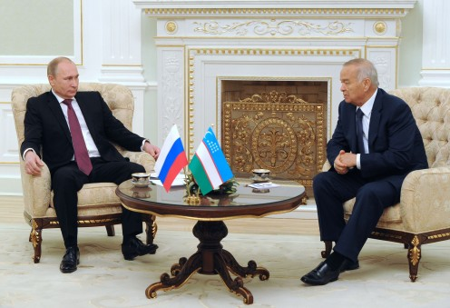 Former Uzbek dictator Islam Karimov meets with Russian President Vladimir Putin (left) at Tashkent International Airport in 2014.