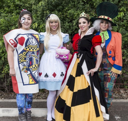 "Encourage the guests to dress up as ""Alice in Wonderland"" characters."