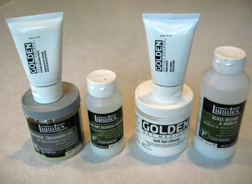 Some of the acrylic mediums that I have in my studio.Slow dry, thickening gel gloss varnish, gloss gel, fiber paste, and coarse molding paste.