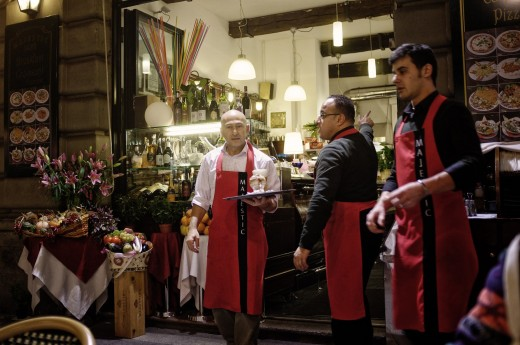 Experienced waiters at a café in Milan, Italy.
