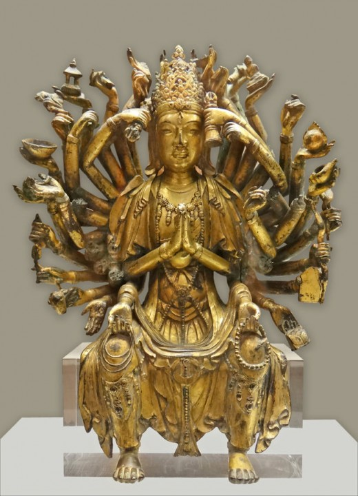 The bodhisattva Guanyin, who strives ceaselessly to aid those in distress. Her many arms represent her power to help all those who need it.