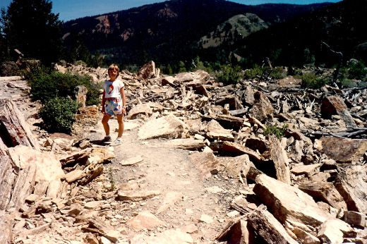 My niece walking amidst the rubble that used to be on top of a mountain in the far distance. Gros Ventre Slide