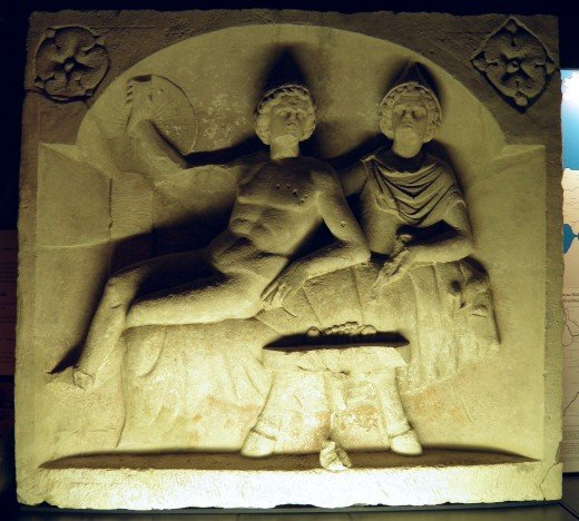 "The god Mithras feasting at a banquet with the ""Sun""."