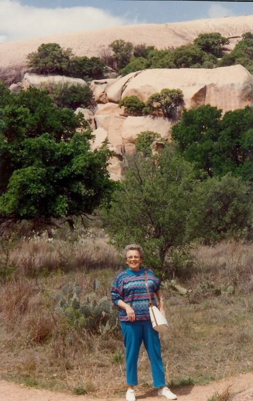 My mother on the trail approaching the rocky area in Enchanted Rock State Park.