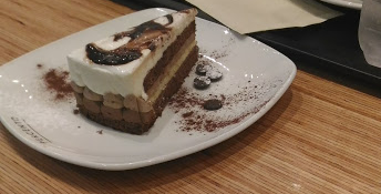 A slice of cake is surely better than a mixture of junk food like fried chips with sauces and a burger.