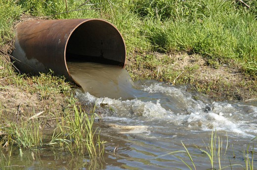 Waste water discharge into a waterbody.