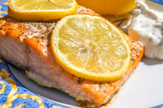 Grilled salmon with a squeeze of lemon makes a very delicious and satisfying meal.