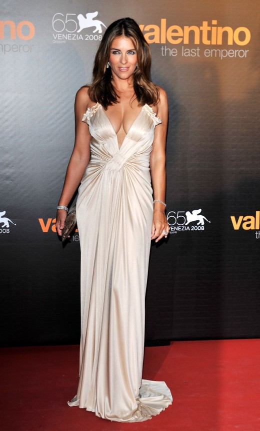 Elizabeth Hurley in a low cut white long evening dress. She has the best cleavage of any celebrity walking the red carpet.
