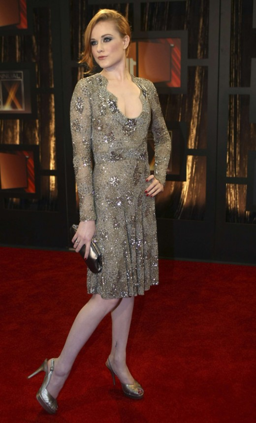 Rachel Evan Wood in a low-cut mid-length evening dress. She's always very pretty and stylish.