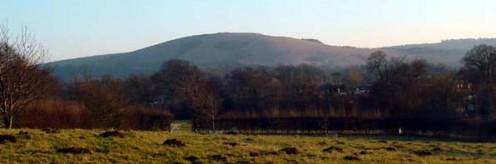 The north face of Wolstonbury Hill across the weald from just south of Hurstpierpoint (where I lived). The picture clearly shows the plateau jutting out to the West which is believed to be an Iron Age Fort.