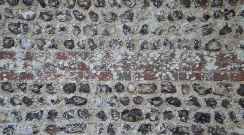 Flint wall in Lewes, Sussex.  You can see the hard, shiny inner & some of the outer stone.