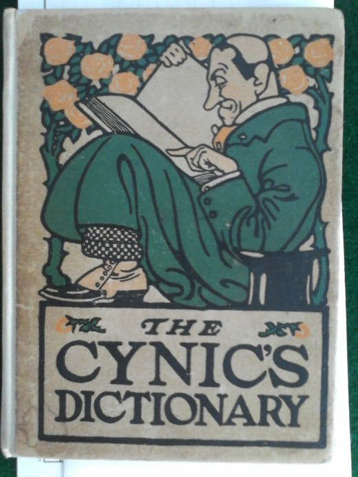 The Cynic's Dictionary (1905), crudely marked at the inspiring pages.