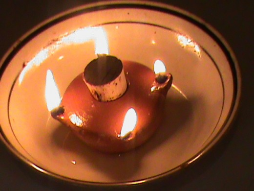 This is a small ceramic lamp that uses veritable oil as a source of light and/or local small space heating.