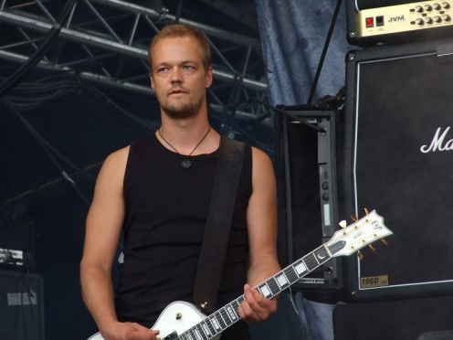 Amorphis guitarist Tomi Koivusaari is seen here performing in 2008. He was doing the vocals for Amorphis before the band hired Pasi Koskinen.