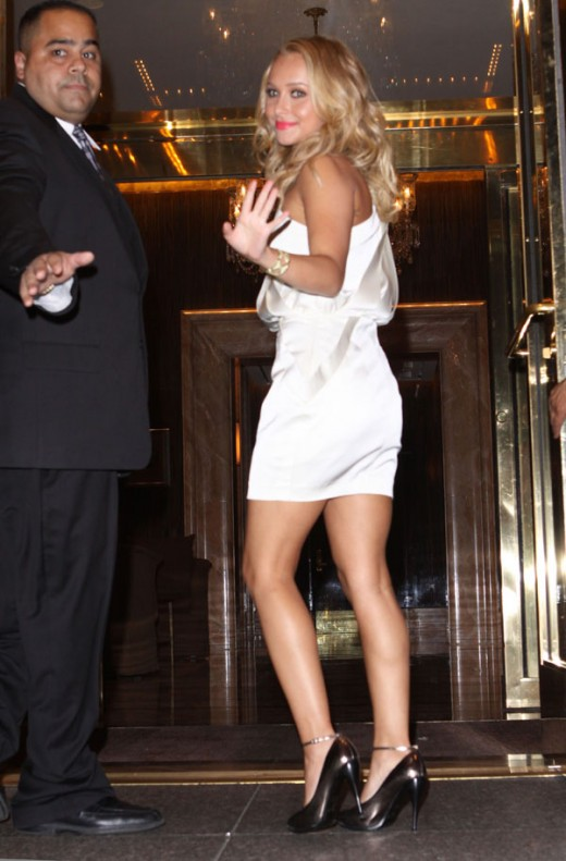 Hayden Panettiere in a short white dress and high heels
