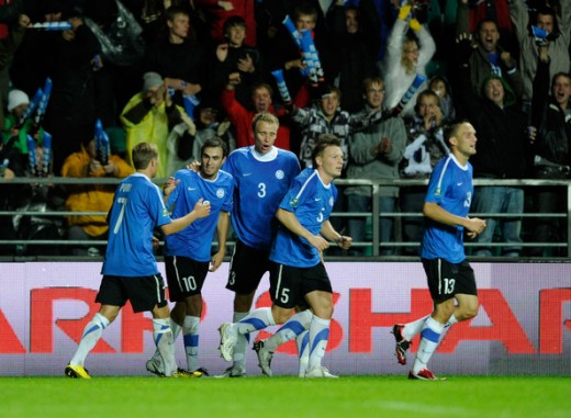 Estonian players congratulate Sergei Zenjov after Estonia opened its Euro 2012 qualifier against Italy with a goal. Despite the 2-1 loss, Estonia would do enough to earn a shock playoff berth one year later.