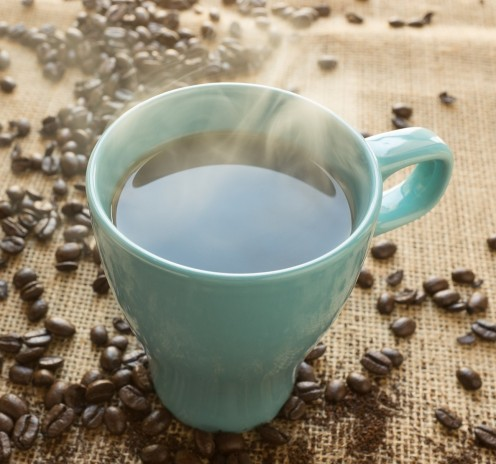 Coffee beans with turquoise mug