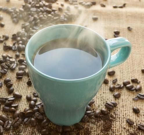 Coffee beans with turquoise mug