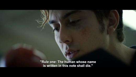 Light Turner (Natt Wolf) reading the Death Note.