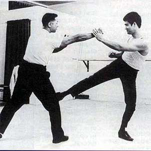 Bruce did give some tactics regarding Jeet Kun Do, but it was always driven by the philosophy of adapting, and attacking.  Different students applied that in different ways.