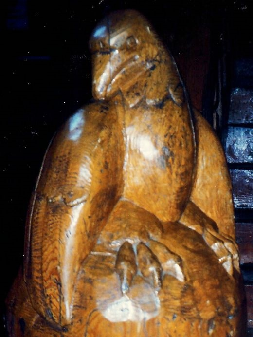 Hand carved bird motif at the end of this banister