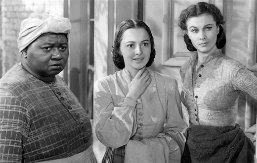 Hattie McDaniel as Mammy with Melanie and Scarlett.
