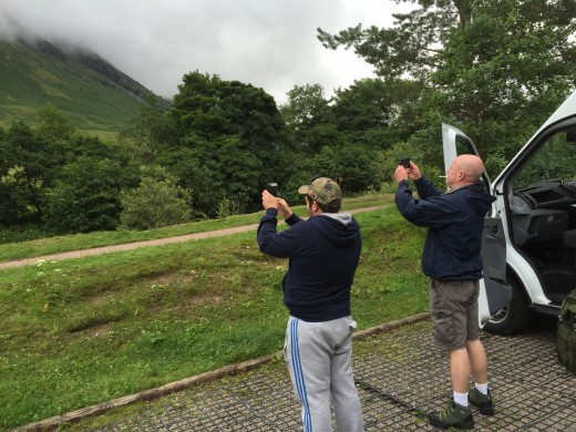 Steve and Rob taking pictures of low based cloud partly obscuring mount Meall an t-Suidhe.