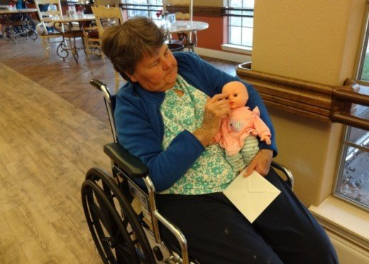 10 more gift ideas for nursing home residents holidappy what do nursing home residents like norma finds comfort in taking her baby doll with her on her daily rounds at the negle Choice Image