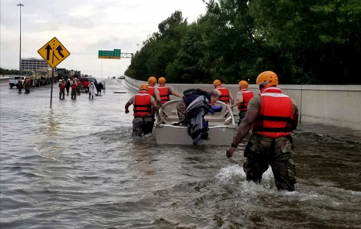 Soldiers with the Texas Army National Guard move through flooded Houston streets as floodwaters from Hurricane Harvey continue to rise, Monday, August 28, 2017.