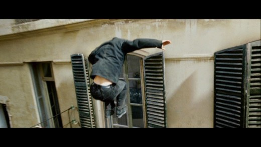 The film retains the series' trademark levels of action including a free-running sequence across roofs and through windows