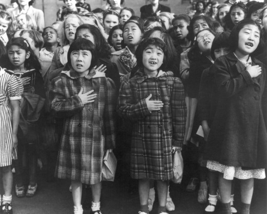 Dorothea Lange's pledge of allegiance photo, highlighting racial diversity and the allegiance of all Americans to the nation, while simultaneously Japanese Americans were interned based solely upon their race.