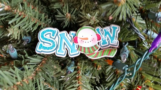 This came as a decoration on a gift box. I saved it, and each year, put it on the tree. It was too cute to toss out with the crumpled wrapping paper. I just nestle it in among the tree branches.