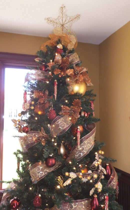 This tree almost touches the ceiling. Disney decorates not just Walt Disney World but all the resort hotels associated with it.  This tree, decorated by the same professionals who decorate the parks, is located at Solivita just south of Kissimmee