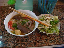 A Bowl of Bun Rieu is Often Served with Steamed Vegetables