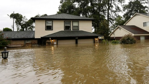 Here's an image of a house submerged up to the top of the first floor. Some people's houses were submerged up to the bottom of the second floor due to the floods.