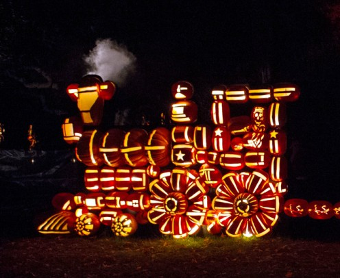 """A pumpkin train is one of the larger displays at the """"Great Jack-o'-Lantern Blaze"""" event."""