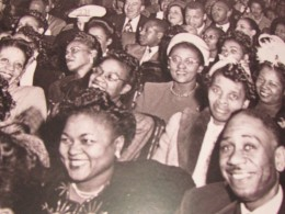 A photo of previous audience members that are displayed within the Apollo publication with its foreword by Smokey Robinson.