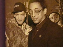 """Photo from the publication of """"Savion Glover and Gregory Hines, appeared, c. 1990. Top right: Poster for Glover's Apollo show 'Improvography.'"""""""