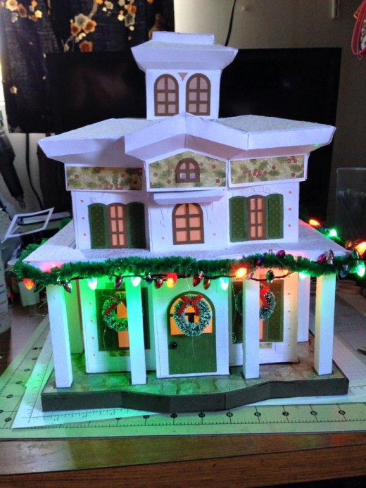 A lighted, beautiful mansion of paper.