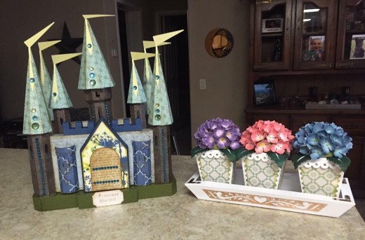 This is a fairy tale castle made for the granddaughter of one of Abby's classmates, Becky Woodell.  The flowers were also made for Becky's mother.