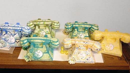 Telephones in paper.