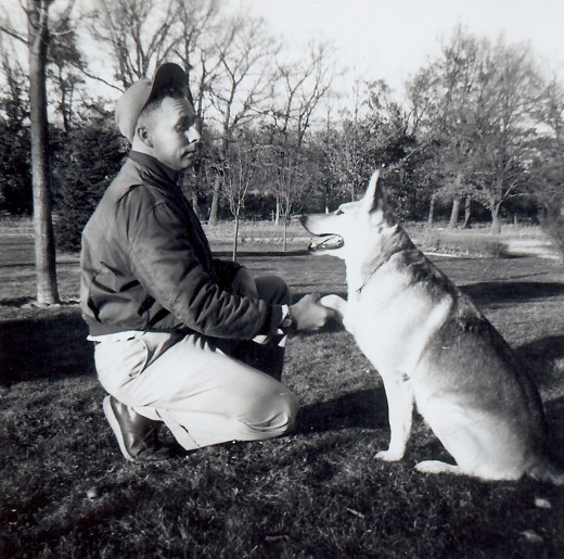 Photo of my Dad shaking hands with family pet Sheba.