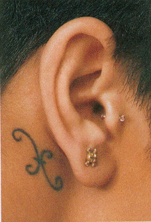 pisces sign behind her ear